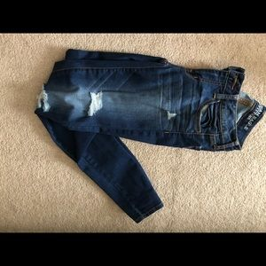 Dark washed jeans with some holes
